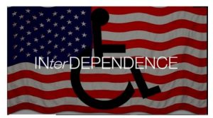 American Flag in the background with the handicap symbol of a person using a wheelchair
